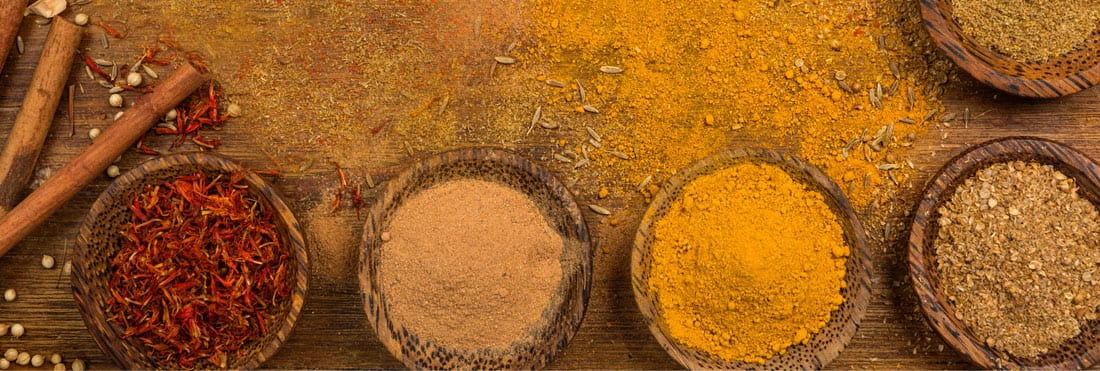 an assortment of spices in beautiful, rustic jars